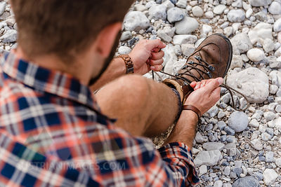 Hiker tying his shoe