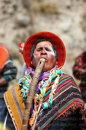 Musician playing a Sariphalka (the largest of the Rollano flute family), Chutillos festival, Potosí, Bolivia