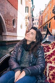 Tourist taking a trip on a gondola, Venice, Italy