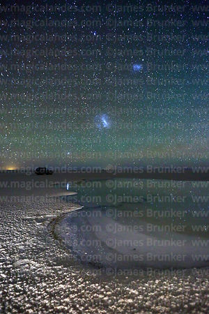 Magellanic Clouds and green airglow above saline pool, Salar de Uyuni, Bolivia