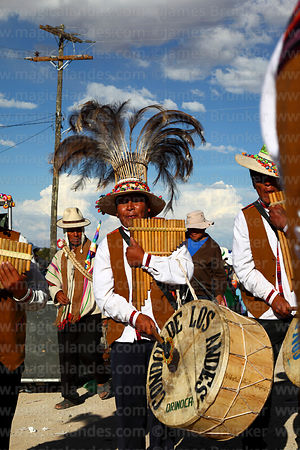 Member of the Condor de los Andes sicureada group playing panpipes / sicus and drum / bombo, Orinoca, Bolivia