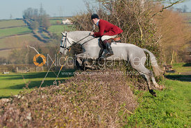 Rowan Cope jumps a hedge in Brooke, Rutland.