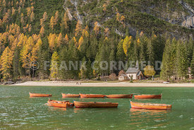 Rental boats at the stunning Lago di Braies a beautiful Alpine lake in wonderful autumn colour.  The Braies lake is in Dolomites, South Tyrol, Italy.