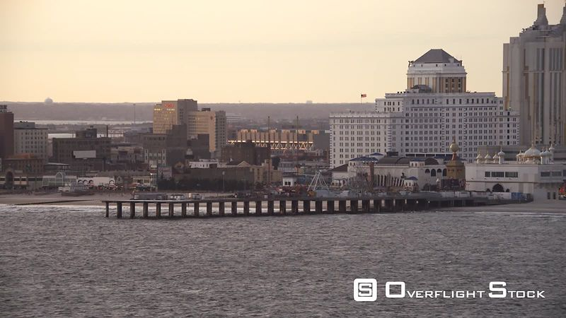 Leaving Atlantic City, New Jersey, looking back at resorts and amusement park on a pier. Shot in November