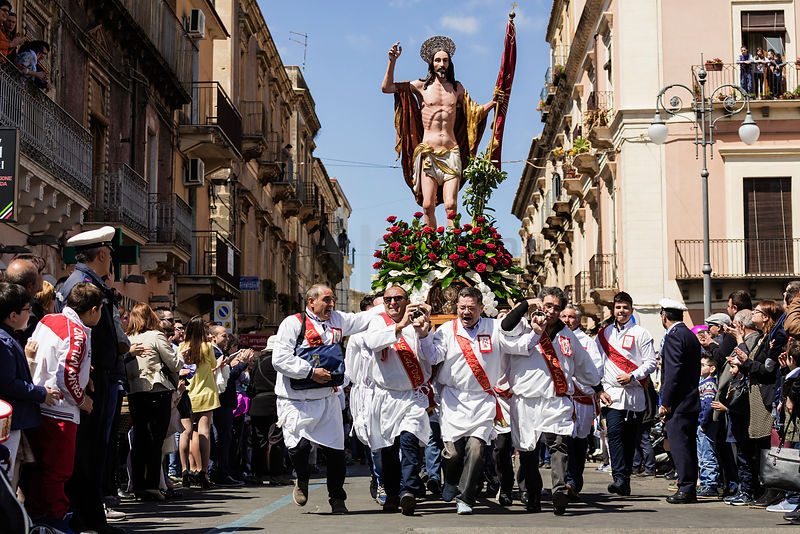 Men Running Carrying a Statue of Jesus at I Diavulazzi I' Pasqua e L'Angelicata