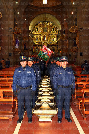 Members of the national guard wait to carry caskets in honour of the members of the Junta Tuitiva out of San Francisco church after mass for a civic ceremony to commemorate the uprising of July 16th 1809, La Paz, Bolivia