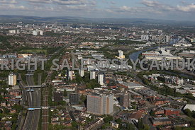 Manchester aerial photograph of the route of the M 602 motorway running parallel with the main railway line into Manchester showing the City and the Manchester Ship Canal and Media City Salford Quays with the hills in the distance