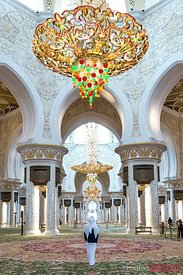 United Arab Emirates, Abu Dhabi. Arabic man inside Sheikh Zayed Grand Mosque