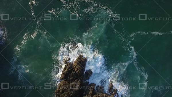 Waves Crashing Into rock Noosa Australia