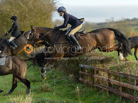 Isobel McEuen jumping a hedge on Deane Bank