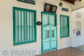 Colourful residence with window shutters on Emerald Hill Road, a  conservation area in the colonial Chinese baroque style architecture.