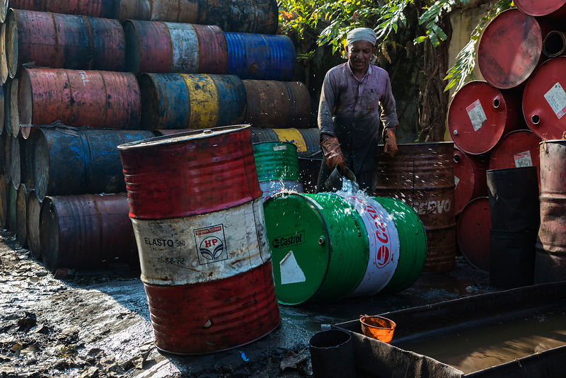 Worker Washing Kerosene off an Oil Drum after Cleaning