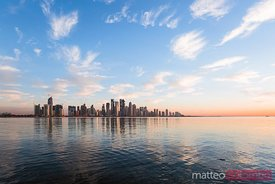 Qatar, Doha. Skyline at sunrise from the Corniche
