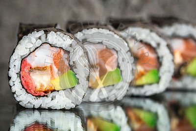 Sushi roll with salmon, shrimps and avocado