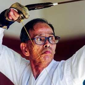 An elderly Kyodo practitioner draws his bow