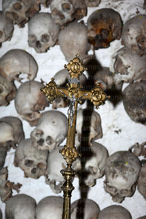 Crucifix and skulls hanging on wall inside tomb of Enrique Torres Belón, church of Santiago the Apostle / Immaculate Conception, Lampa, Peru
