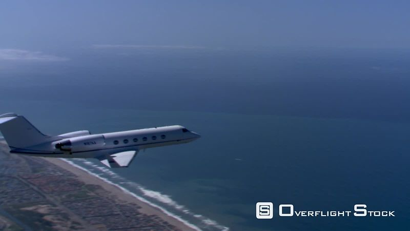 Air-to-air view of jet heading over ocean
