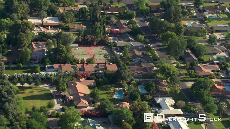 Mid-level flight over suburban residential area in Phoenix.