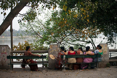 India - Chandannagar - Elderly women sit and talk on a bench on the Strand overlooking the Hooghley River
