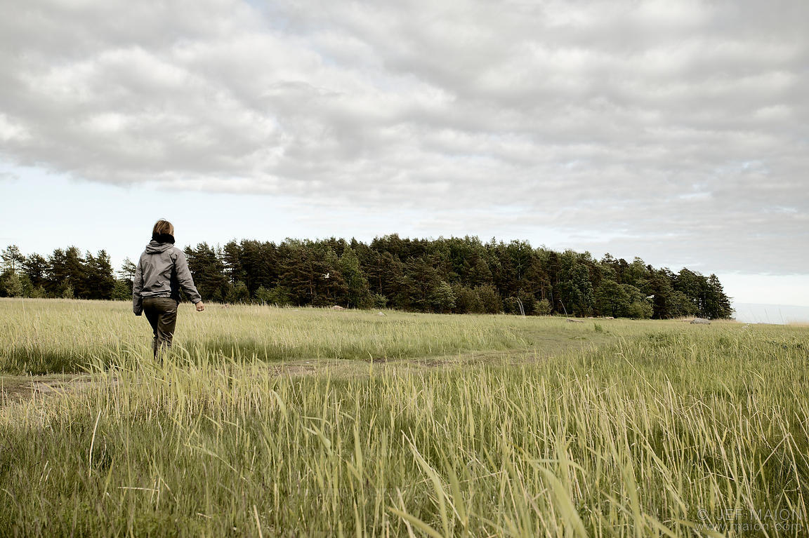 Woman walking in green field