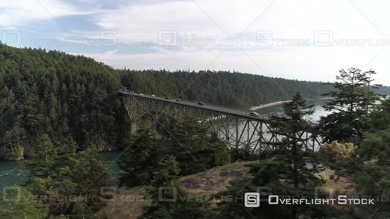Deception Pass bridge with travelers crossing on beautiful sunny day. Deception Pass Washington USA
