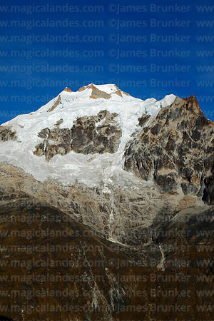 East face of Mt Huayna Potosí showing rock exposed by receding glaciers, Cordillera Real, Bolivia