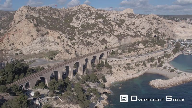 Aerial view of the Corbiere train viaduct in Estaque village, filmed by drone, Marseille, France