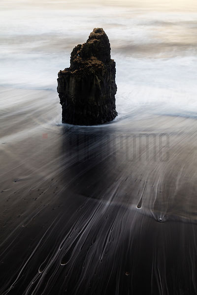 Receding Wave with Sea Stack on Kirkjufjara Beach