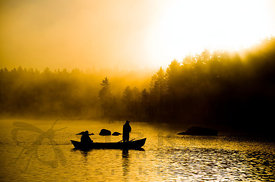 Fishermen in morning fog