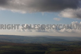 Clouds landscape aerial view looking over farm land and Moorland Inchfield with Todmorden Moors in the distance