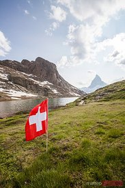 Swiss flag near the Riffelsee, Matterhorn, Switzerland