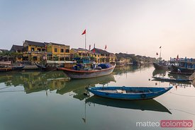 Vietnam, Hoi An. View of the river in the morning with fishing boats