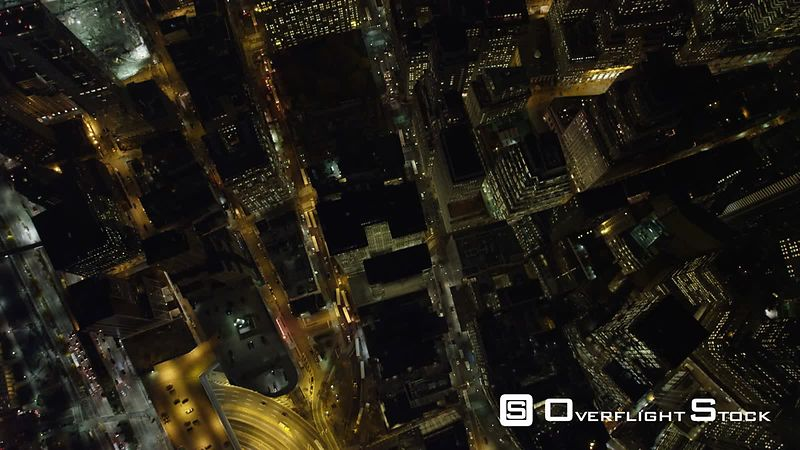 Flying south over New York Financial District at night, looking straight down.