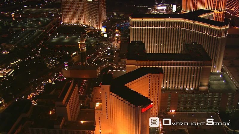 Close flight over casinos from Harrah's to the Palazzo in Las Vegas at night.