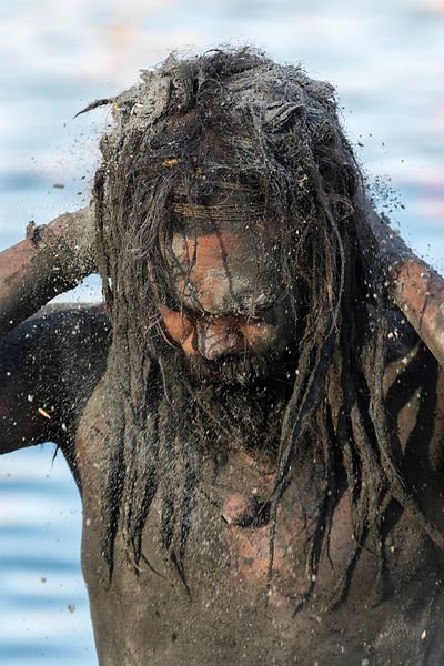 Portrait of a Naga Sadhu Applying Ash after a Holy Dip in the Shipra River