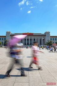 Local people walking in Tiananmen square in a sunny day, Beijing, China