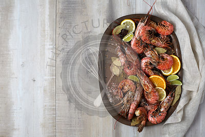 Cooked red shrimp on a light background. Served on a tin plate.