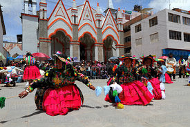 Dancers from Capachica area in front of Sanctuary of Virgen de la Candelaria, Puno, Peru