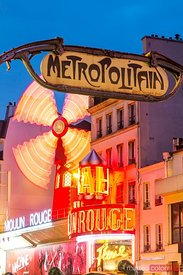 Famous Moulin Rouge and metro sign at night, Paris, France