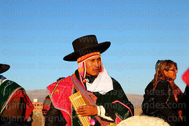 Sicuris musician holding sicu (panpipe or zampoña) during Aymara New Year celebrations, Tiwanaku, Bolivia