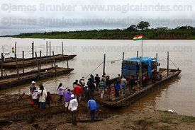 Truck and passengers boarding raft to cross the River Mamoré between San Ignacio de Moxos and Trinidad , Beni , Bolivia