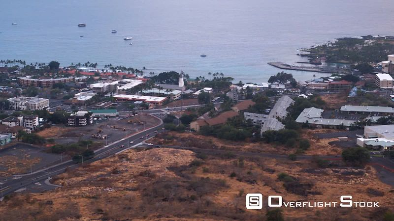Flying over Kona Town, Hawaii, with wide view of bay.