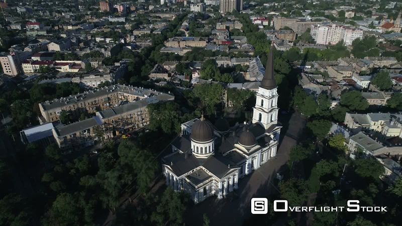 Drone camera flies slowly towards and tracks the spire of Preobrazhensky Cathedral on Saborna Square in Odessa Ukraine.