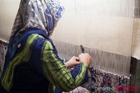 Woman weaving silk in Kashgar, Xinjiang, China