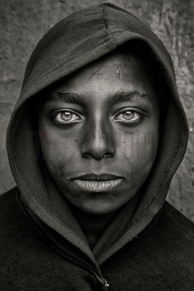 Young Boy with Haunting Eyes