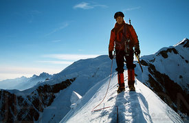 Climber on the summit of the Bionnassay Aiguille