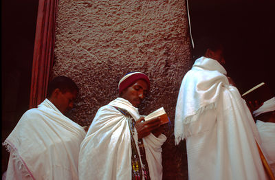 Ethiopia - Lalibela - Monk chanting prayers at Lalibela, Ethiopia