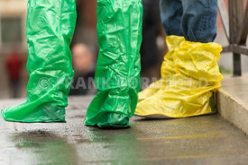 Coloured waterproof boots worn by tourists in Venice, Italy during a flood.