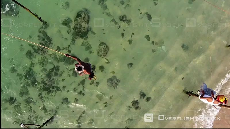 Aerial View of Fishermen on Pole in the Sea, Sri Lanka, Filmed by Drone, Bentota