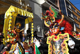 China Supay / female devil diablada dancers passing statue of Señor del Gran Poder outside Sanctuary, La Paz, Bolivia